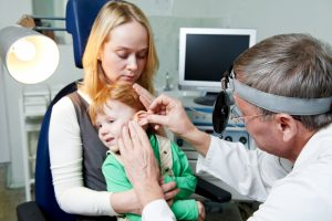 Medical otitus examination of child doctor